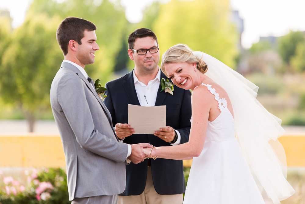 Candid wedding picture of bride and groom laughing at The Hangar at Stanley Marketplace | Best Colorado Wedding Venues