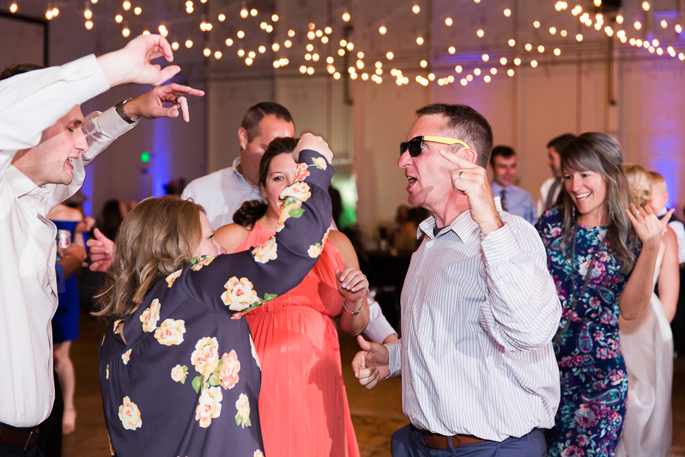 Wedding guests dancing in the Hangar at Stanley Marketplace | Candid Aurora, CO wedding photography