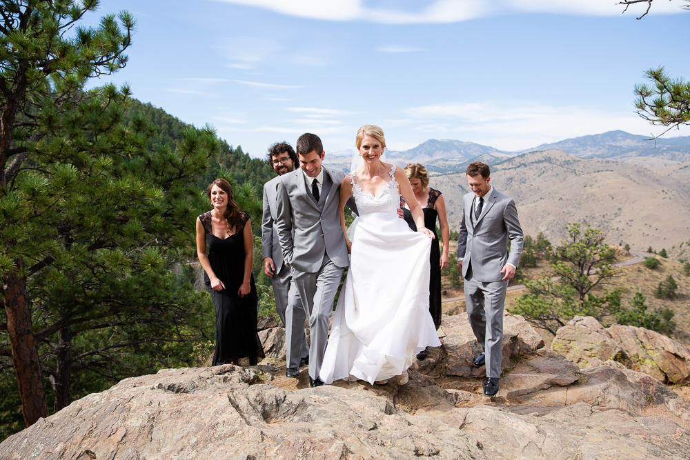 Bridal party walking across the rocks at Lookout Mountain in Golden, Colorado
