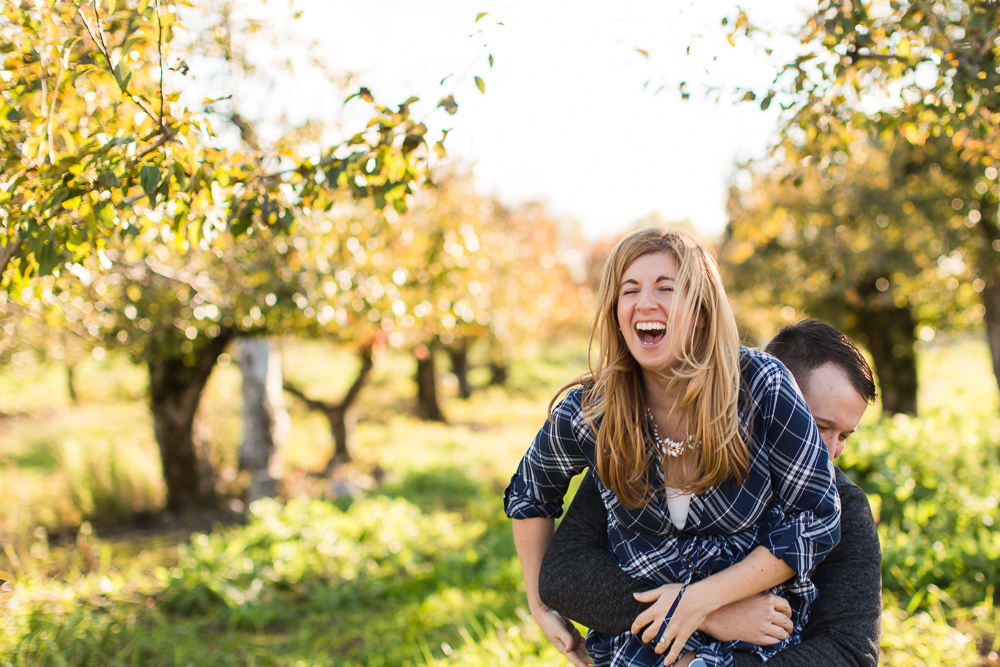 Fun and candid engagement photography at an apple orchard in the Hudson Valley   New York engagement photographer