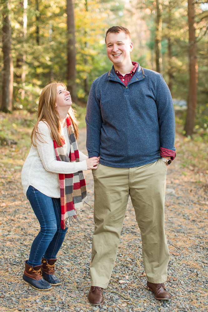 Engaged couple laughing during their fall engagement photo shoot   Hiking engagement pictures in NY