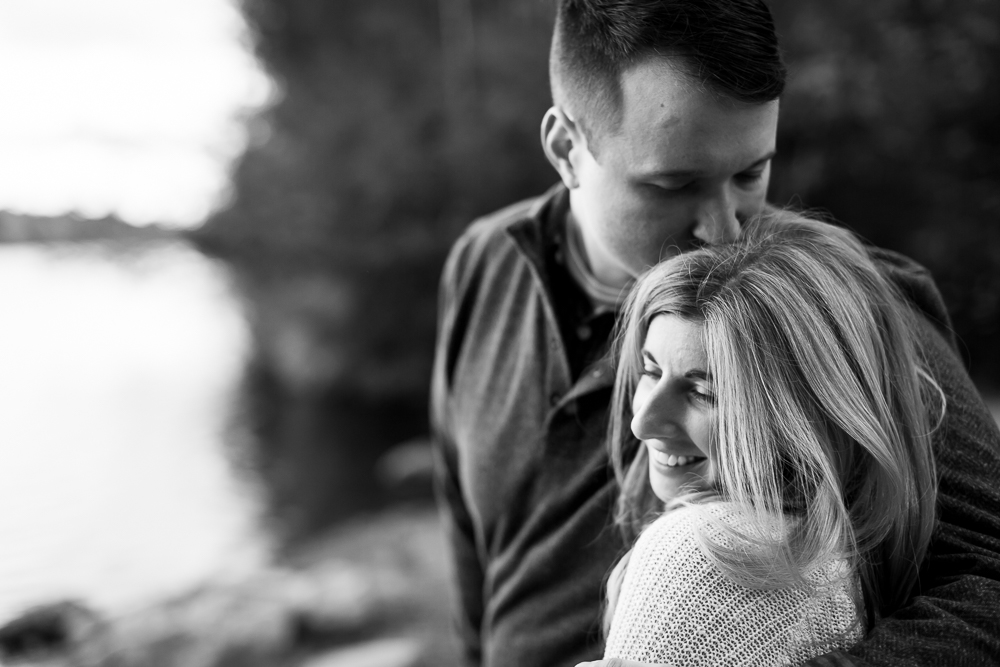 Romantic kiss on the forehead by the lake at Minnewaska State Park   Hudson Valley engagement photography locations