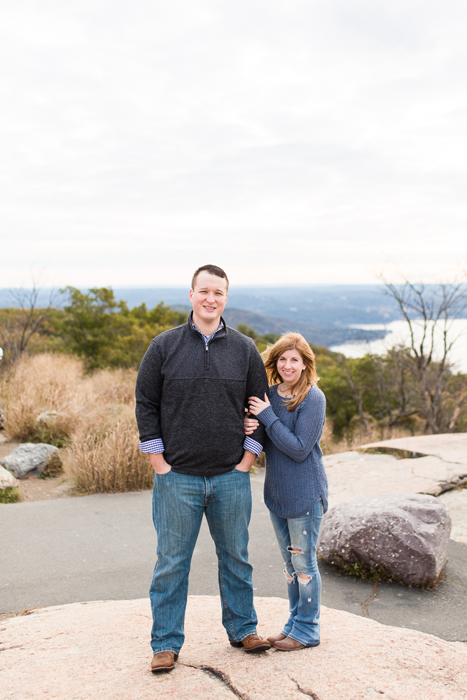 Engaged couple dressed in blue overlooking the Hudson River at Bear Mountain State Park, New York