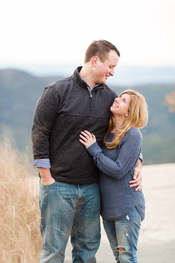 Engaged couple looking at each other during a Hudson Valley engagement shoot