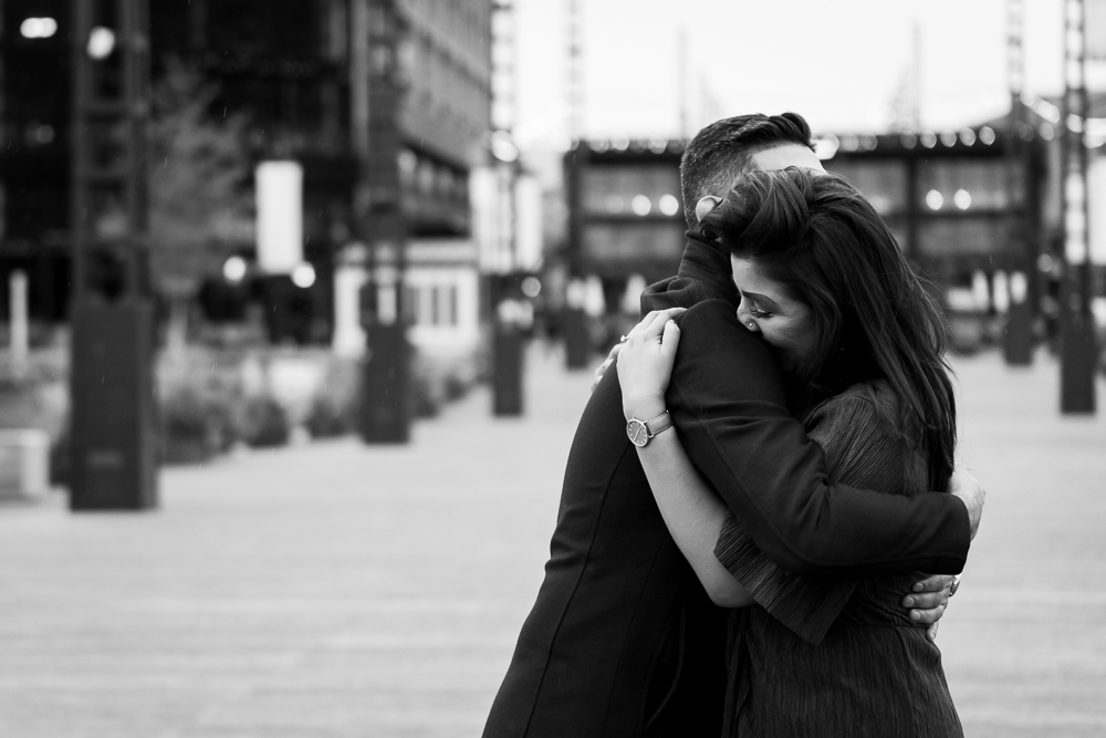 Candid photo of couple hugging after she said yes to the proposal | DC Wharf Photography