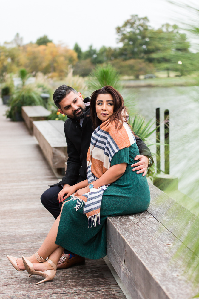 Romantic engagement photo on bench at the end of District Pier | Wharf DC engagement pictures