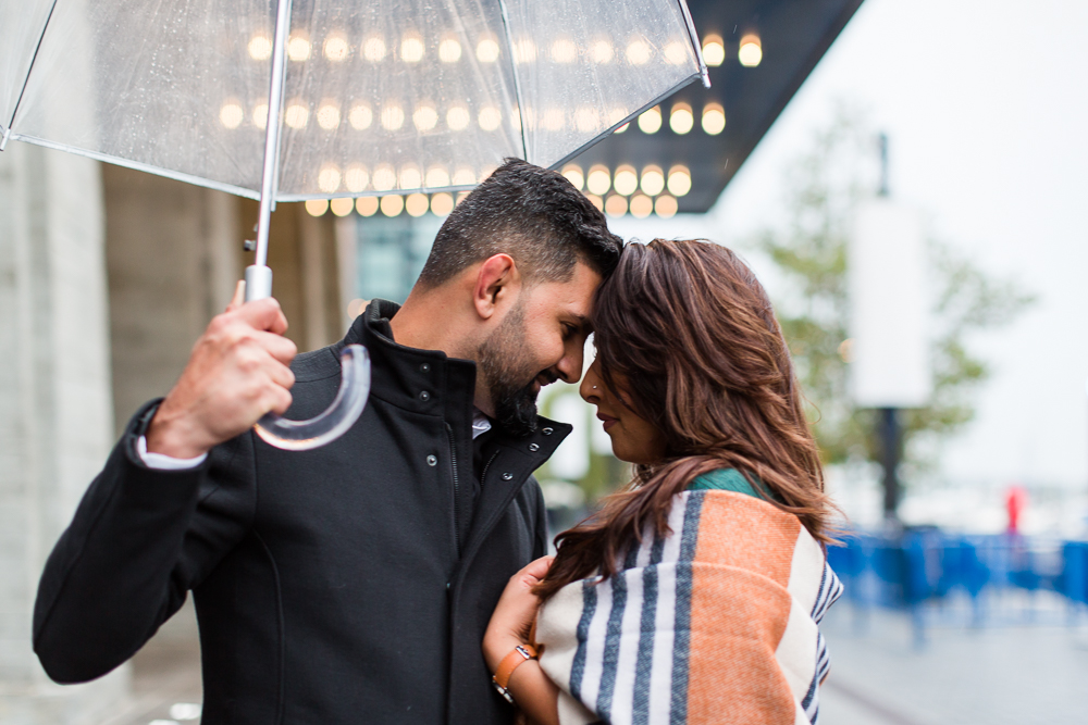 Rainy engagement pictures by The Anthem theater at District Wharf | Washington, DC engagement locations