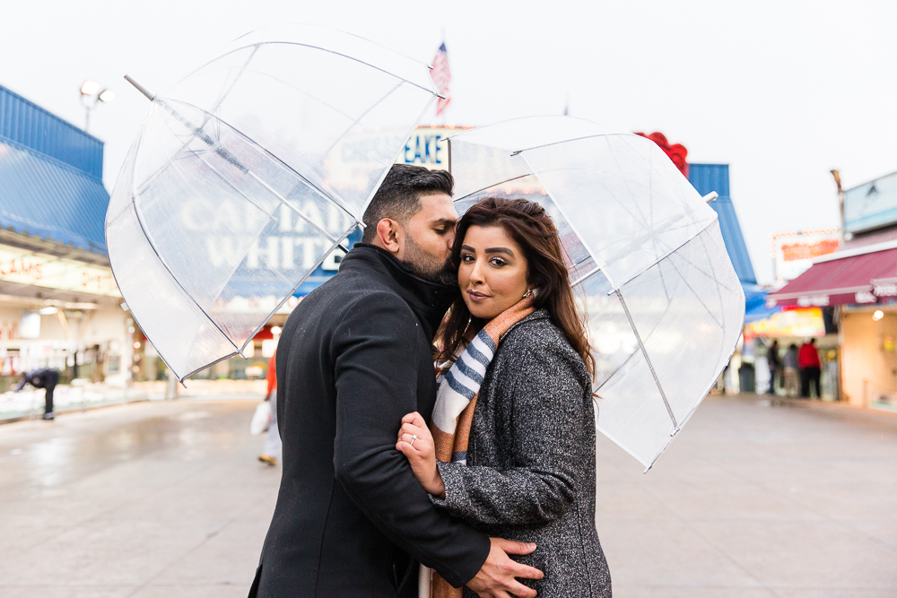 Giving his new fiance a kiss in the rain at the Wharf Fish Market in DC