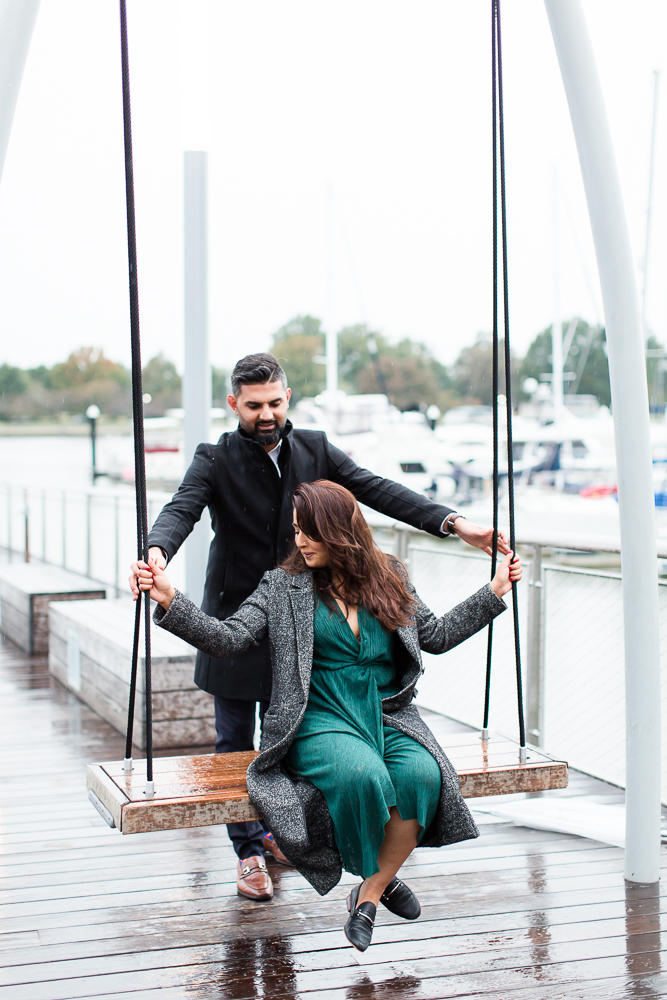 Engagement pictures on the swings at District Wharf