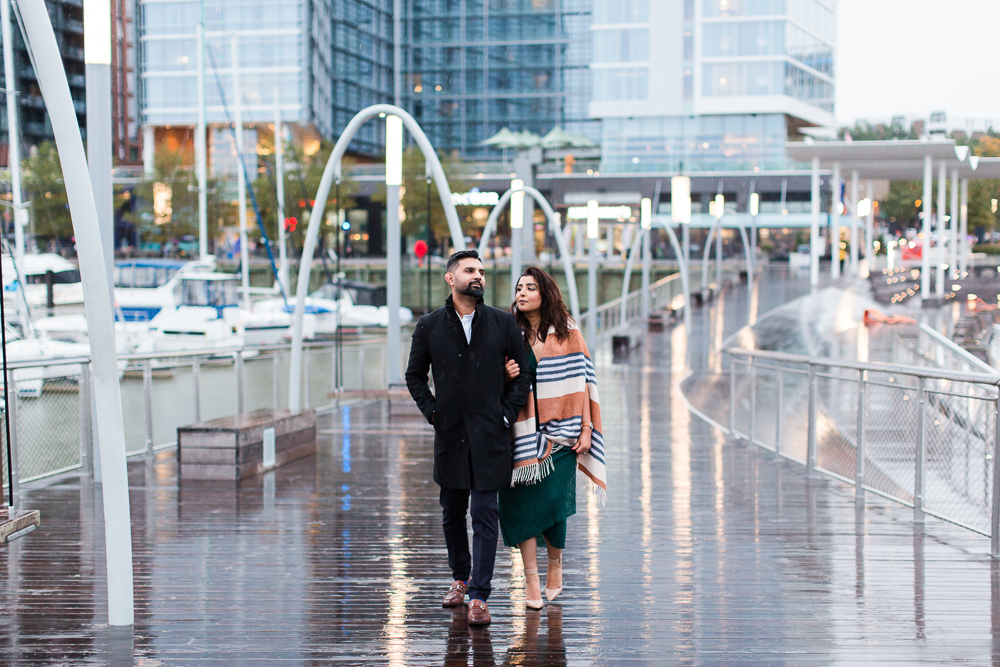 Walking along the pier in the rain | District Wharf engagement photos