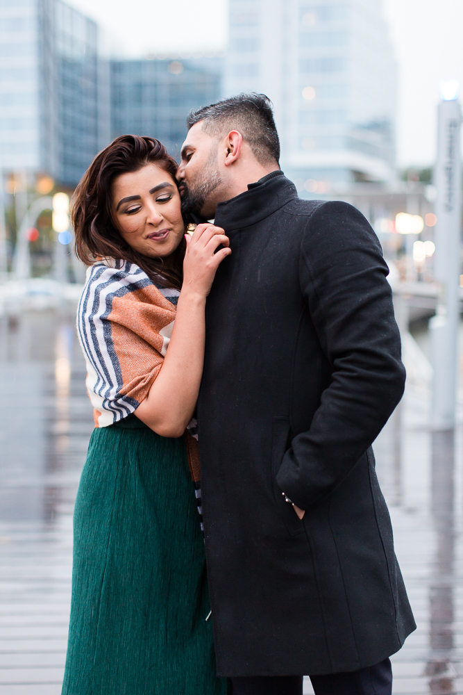 Rainy engagement pictures on the pier at the DC Wharf