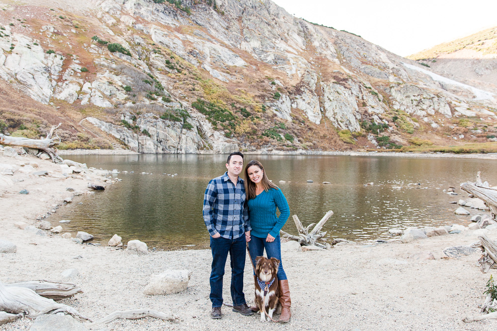 Happy family standing by the lake at St. Mary's Glacier in Idaho Springs, Colorado