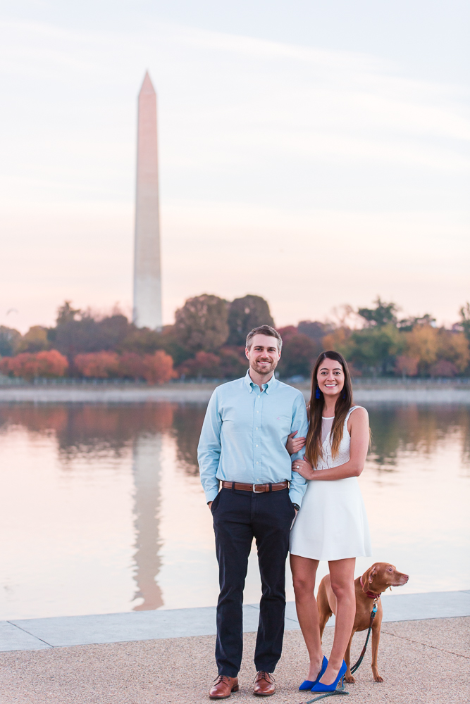Happy engaged couple with their dog in DC