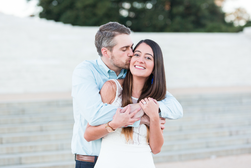 Giving his fiance a kiss on the cheek in front of the Thomas Jefferson Memorial