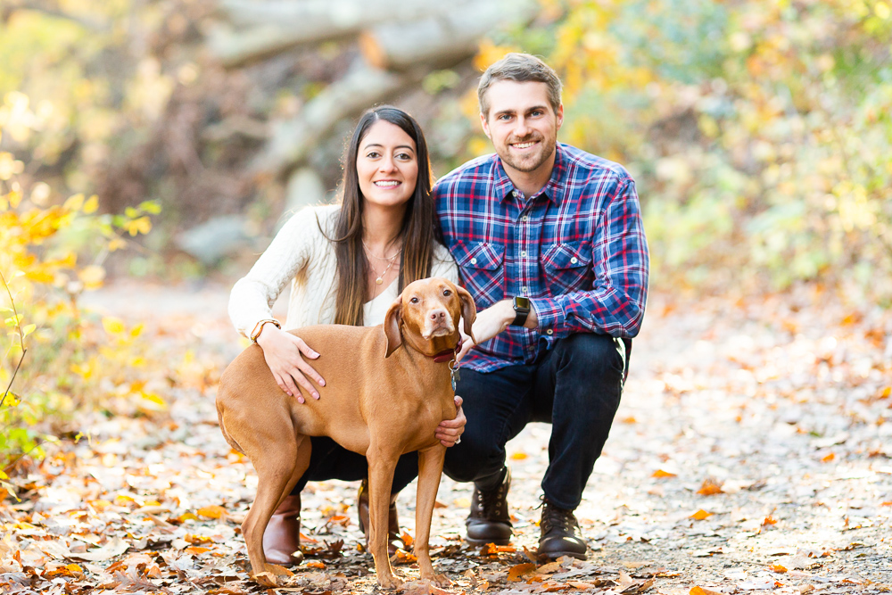 Fall engagement pictures with dog on the trail at Rock Creek Park in Washington, DC