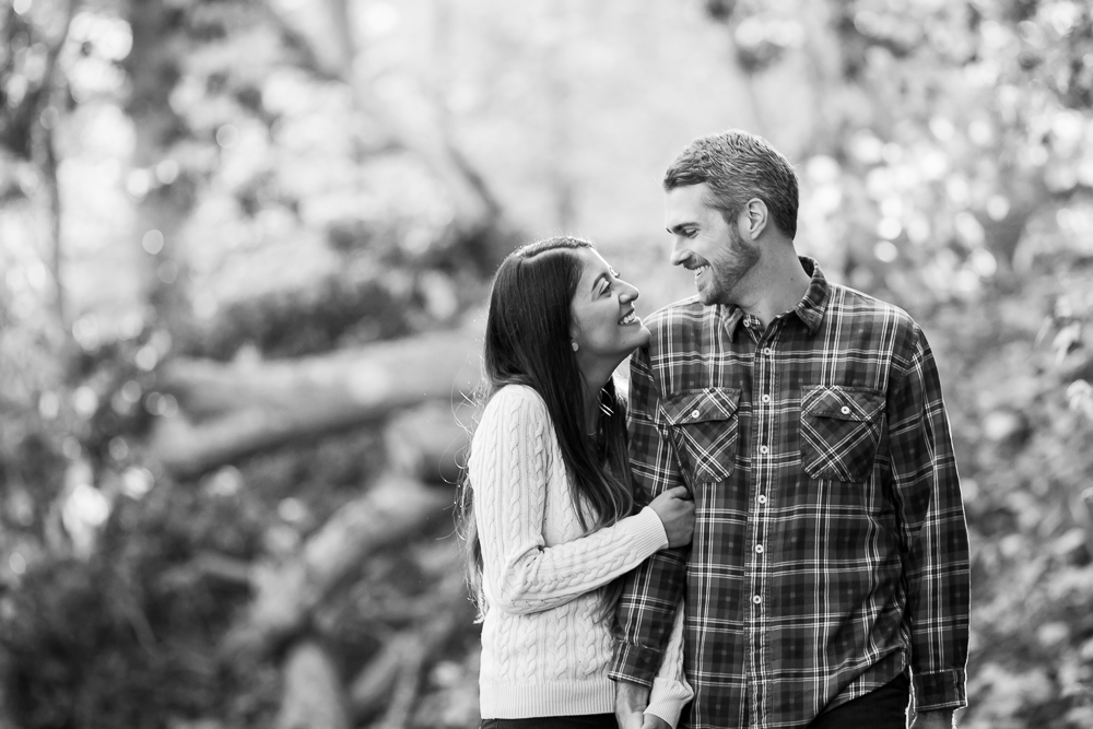 Candid moment between engaged couple at Rock Creek Park in Washington, DC