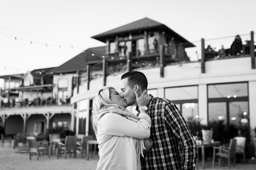 Newly engaged couple kisses after surprise proposal in Leesburg, Virginia | Stone Tower Winery Photos