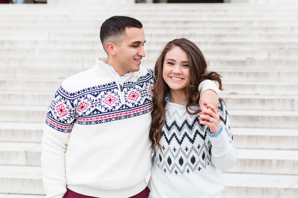 Sweet couple in winter sweaters on the steps of the Lincoln Memorial