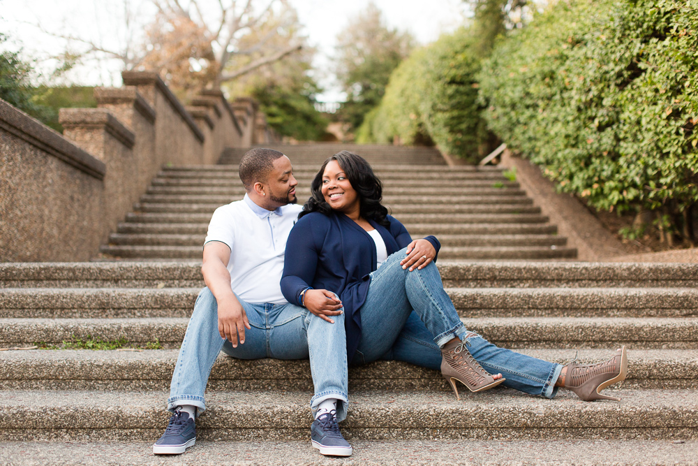 Happy couple that just got engaged, sitting on the staircase at Meridian Hill Park | Best DC engagement photographer