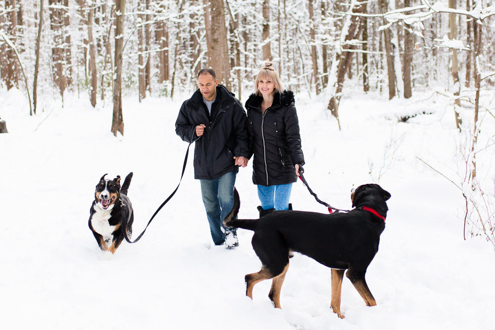 Fun and candid engagement photography in the snow during winter in Northern Virginia