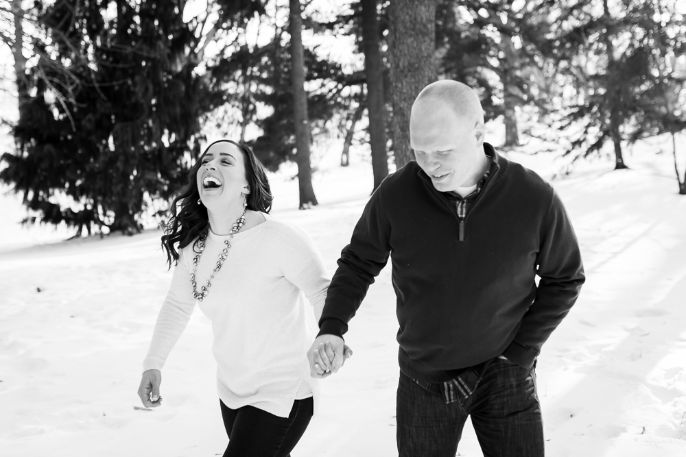 Candid moment of laughter while playing in the snow at Highland Park | Candid Rochester NY Photographer