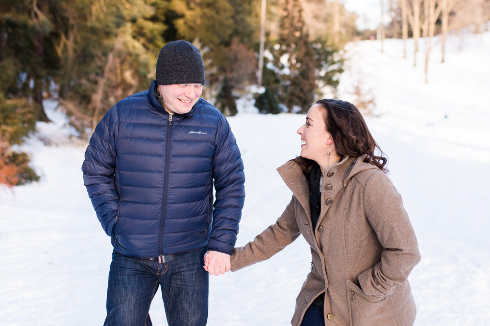 Laughing on the sledding hills of Highland Park | Rochester, NY winter engagement pictures