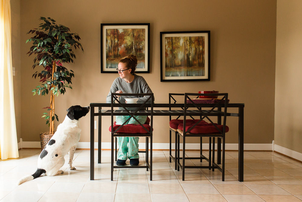 Dog sitting next to the kitchen table, hoping to get some breakfast | Documentary style dog photographer in Northern Virginia and DC