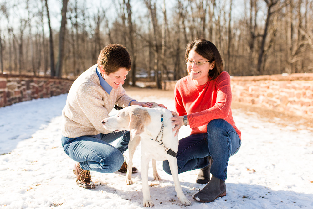 Winter engagement session in the snow with their dog at Manassas Battlefield | Northern Virginia LGBTQ engagement photography