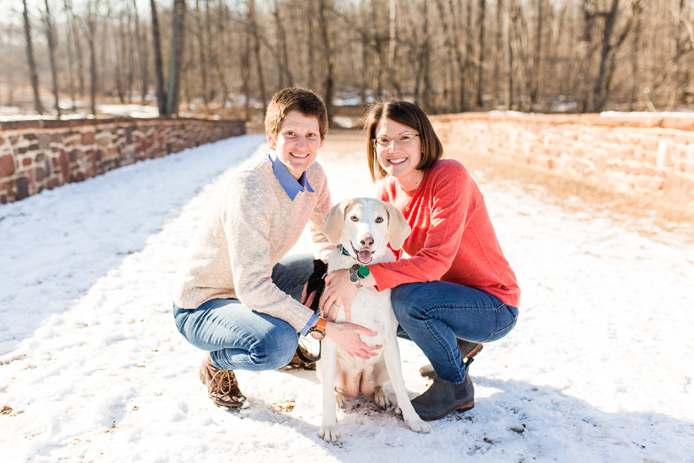 Lesbian couple with their rescue dog during a winter engagement shoot in Northern Virginia