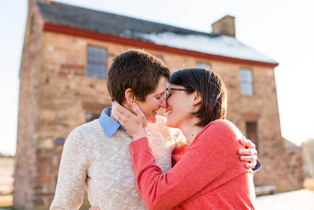 Same-sex engagement photo in front of the Stone House at Manassas National Battlefield Park | Stone House engagement pictures