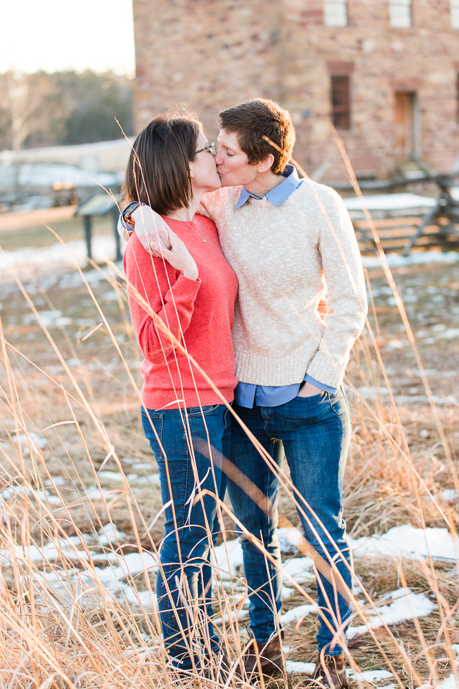Engaged couple kisses during snowy engagement session | Northern Virginia battlefield engagement pictures