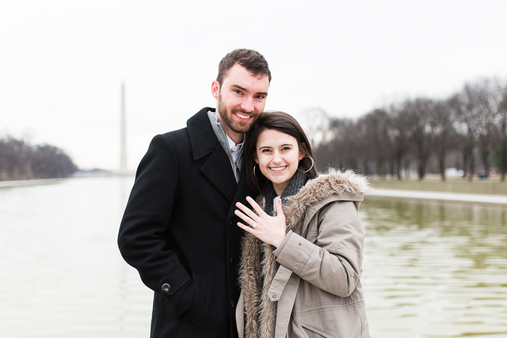 Showing off her new engagement ring after the surprise proposal   Reflecting Pool engagement photos