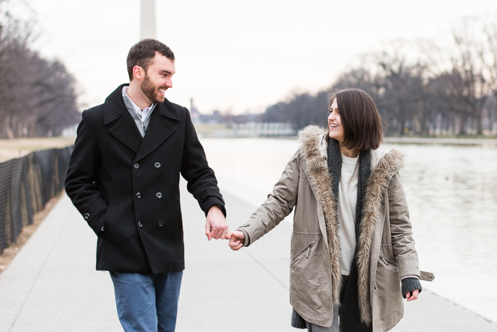 Cute couple smiling at each other after they just got engaged   Proposal at the National Mall