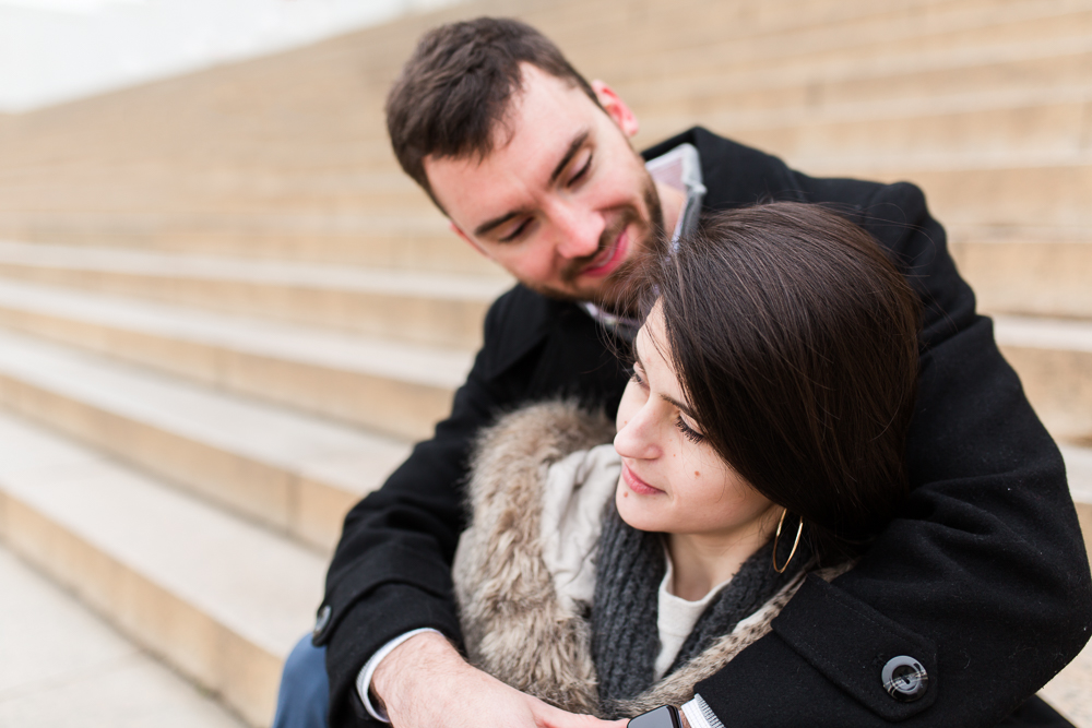 Engagement photo cuddling on the steps of the Lincoln Memorial | Classic Washington DC engagement pictures