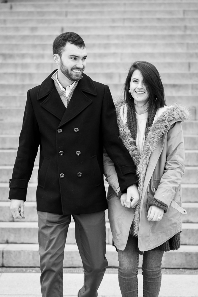 Candid engagement pictures on the steps of the Lincoln Memorial