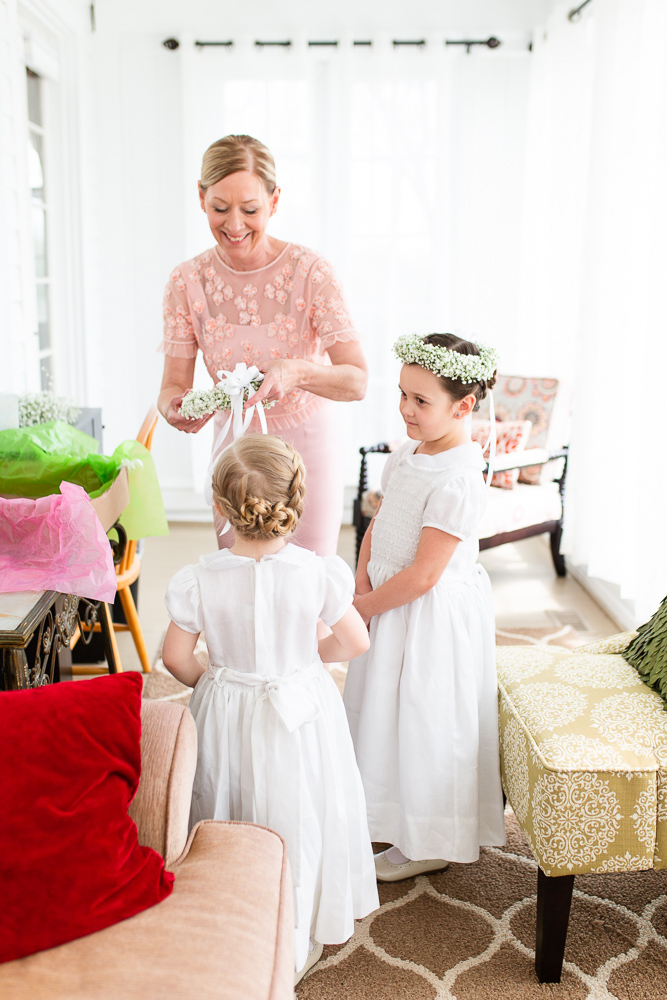 Flower girls putting on their flower crowns before the spring wedding in Warrenton, VA