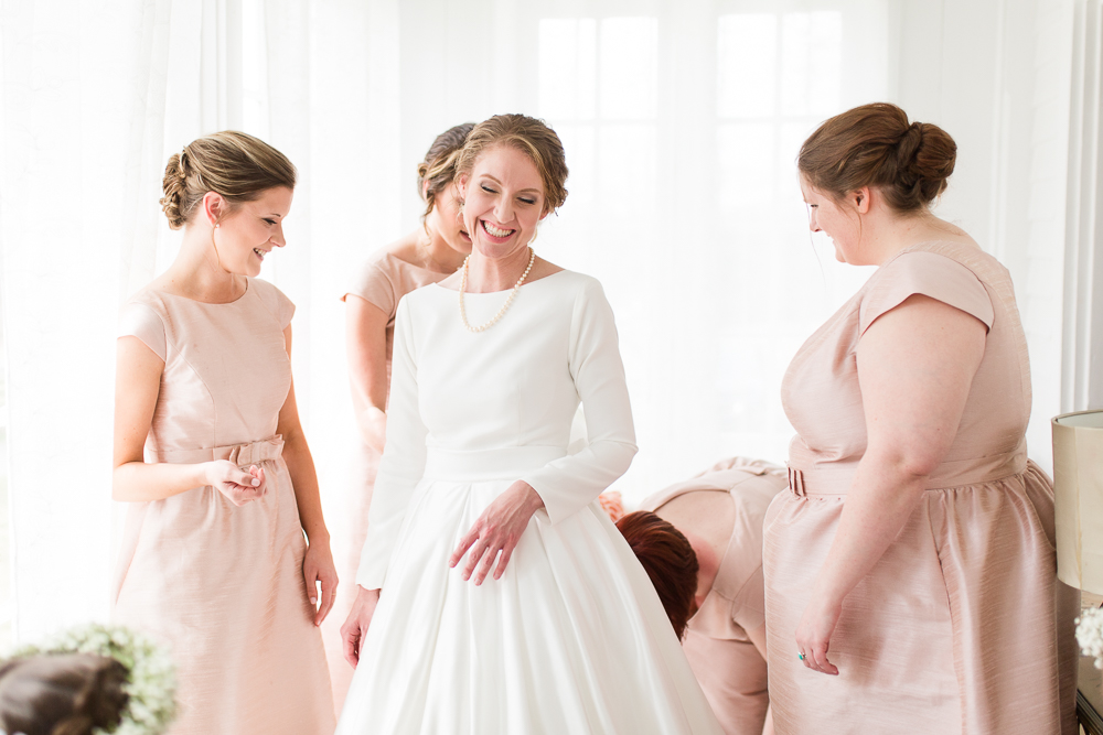 Candid Warrenton, Virginia wedding photography as bride and bridesmaids get ready in the bridal suite