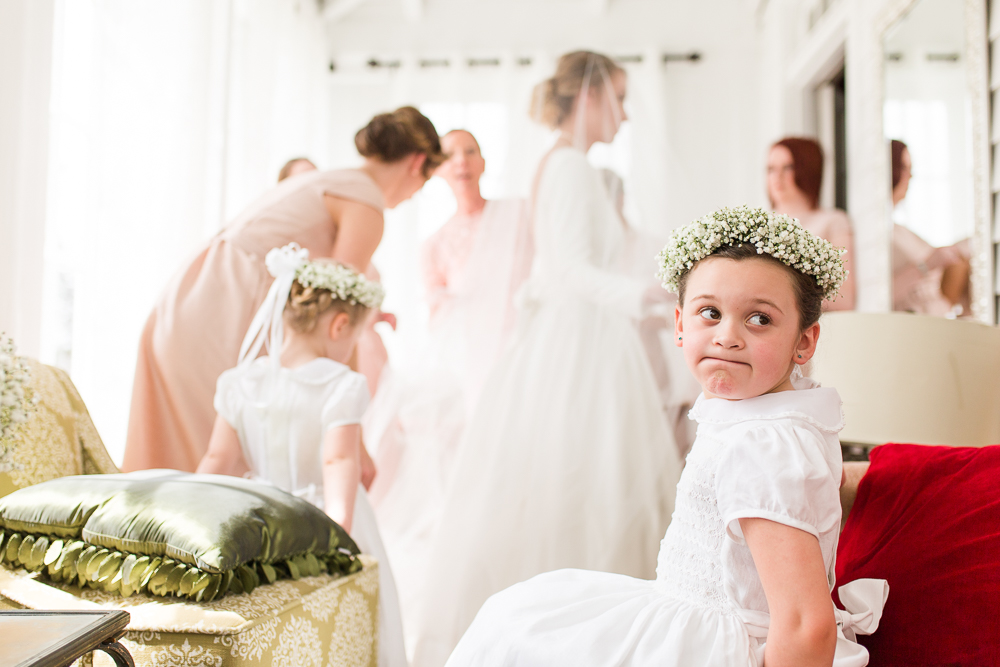 Flower girls watching the bride get ready for her wedding at the Black Horse Inn, Warrenton, Virginia