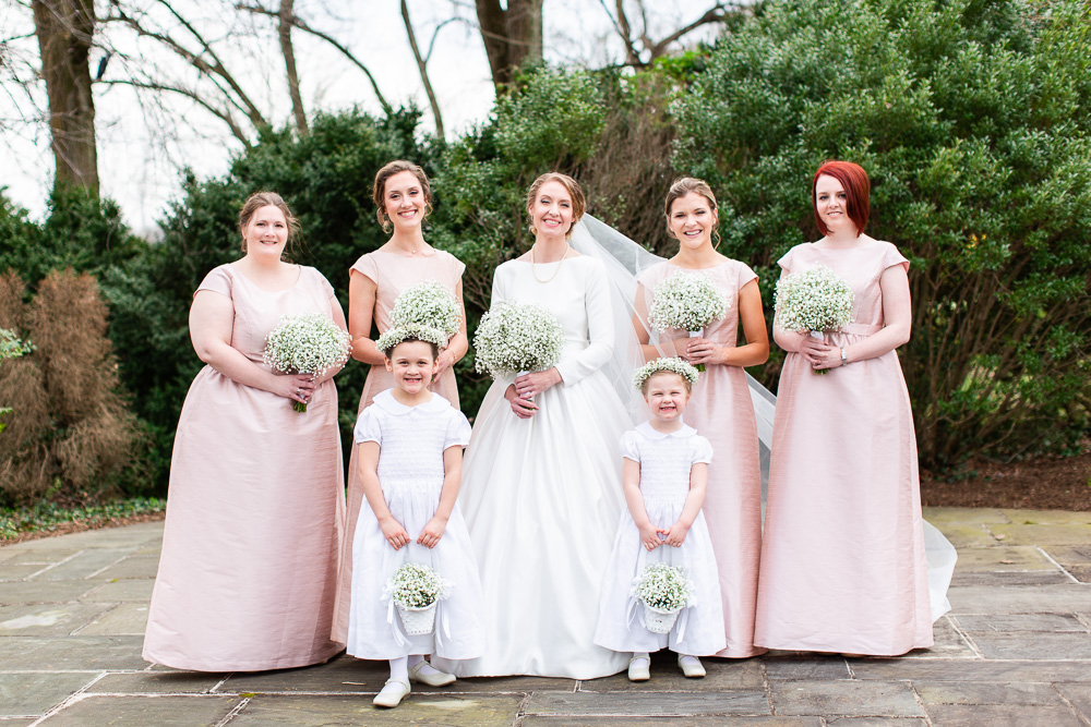 Bridal party dressed in ballet pink on the patio at Black Horse Inn