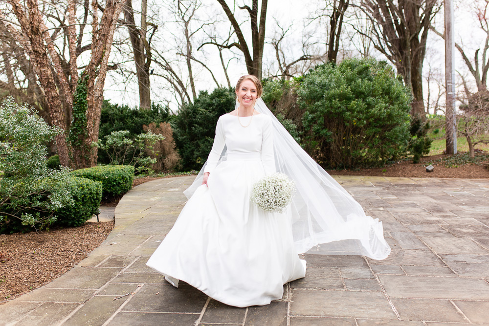 Bride walking across the patio at Black Horse Inn | Warrenton, Virginia wedding photography