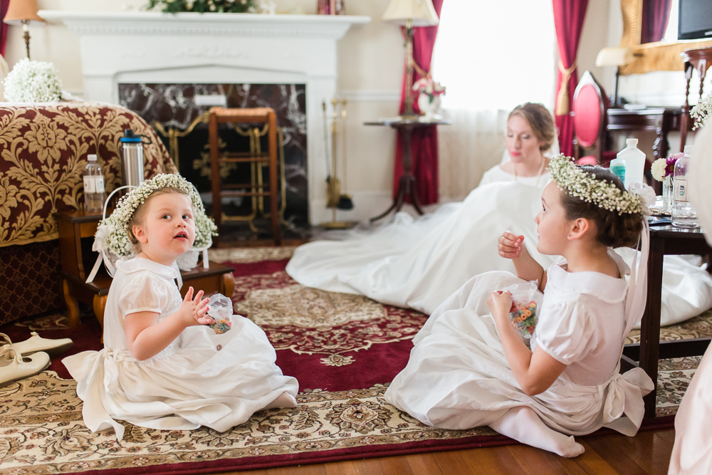 Candid photo of flower girls eating snacks before the wedding | Candid Warrenton Virginia wedding photographer