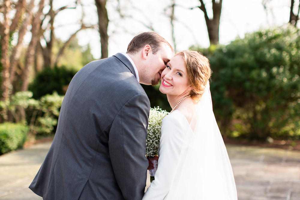 Groom giving bride a kiss on the cheek | Black Horse Inn wedding pictures