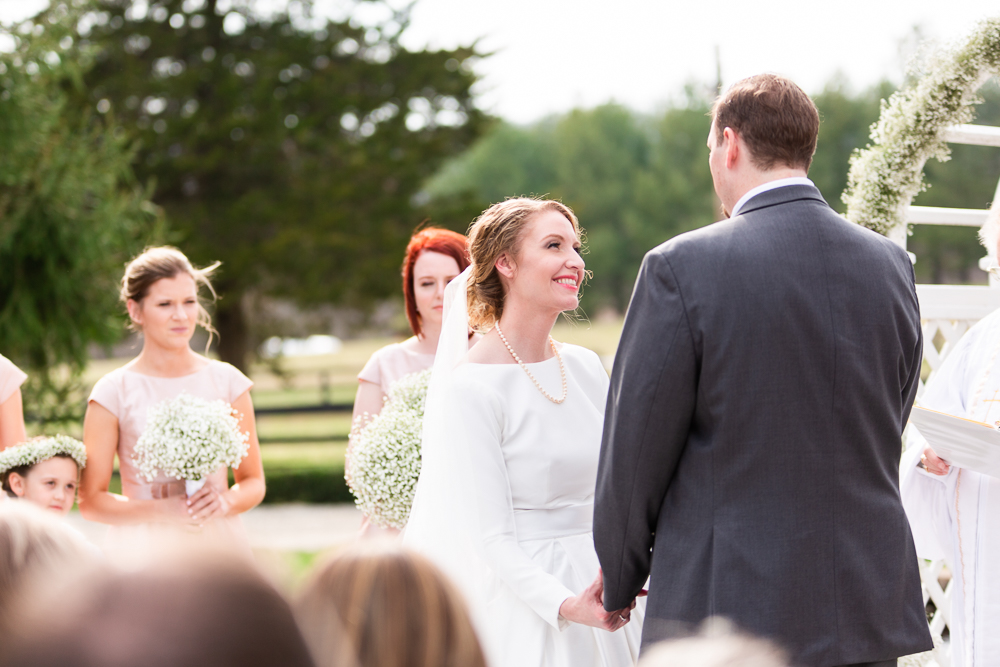 Bride smiling up at the groom during the wedding ceremony