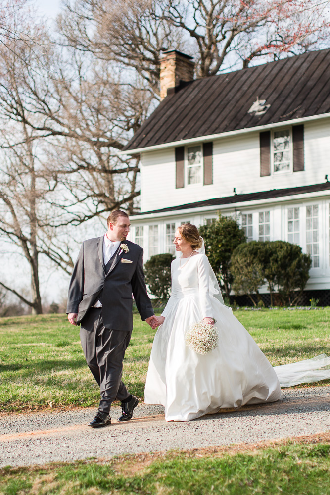 Husband and wife walking in front of the Black Horse Inn | Warrenton, Virginia wedding photography