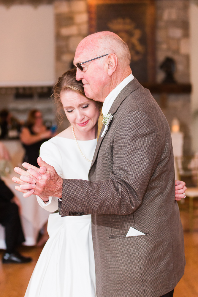 Candid moment of bride dancing with her grandfather