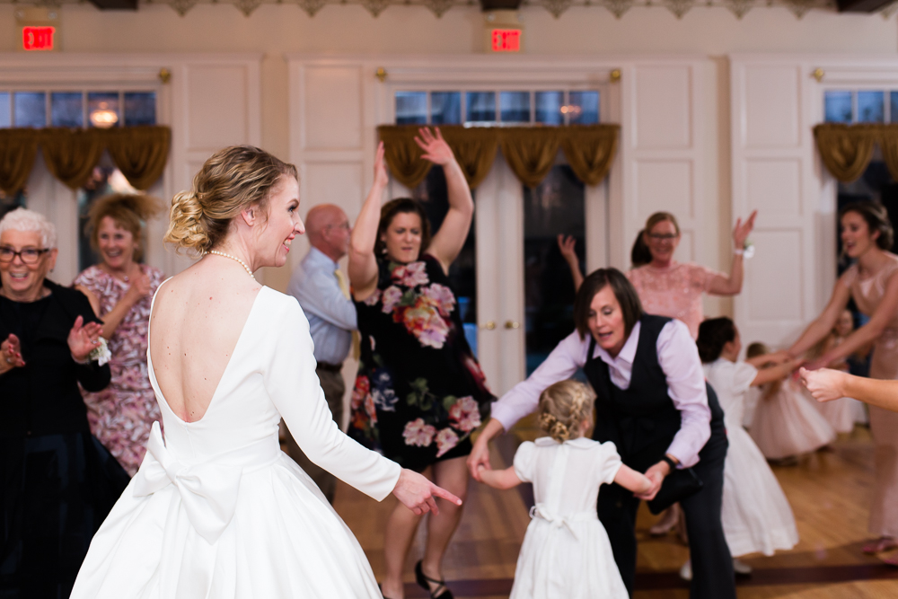 Bride dancing with her wedding guests