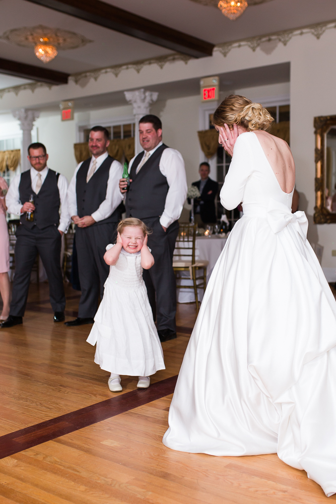 Bride having fun with her flower girl on the dance floor