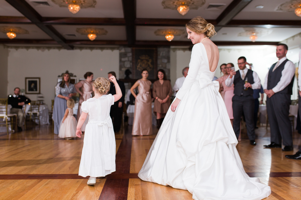 Bride and flower girl dancing during the wedding reception at Black Horse Inn, Warrenton Virginia
