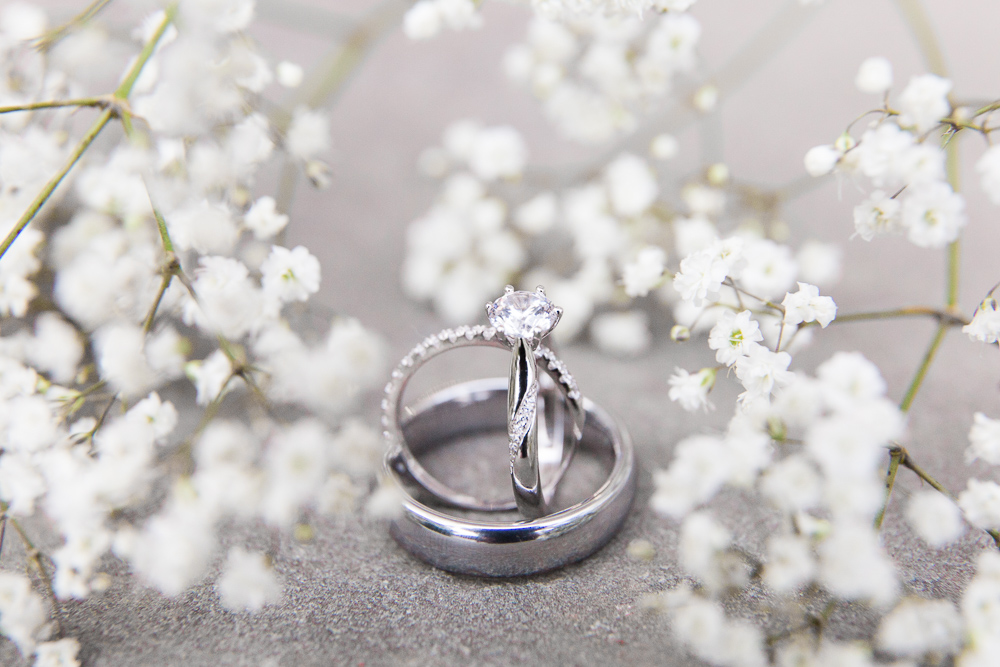 Wedding bands and engagement ring in baby's breath | Warrenton, Virginia wedding photography