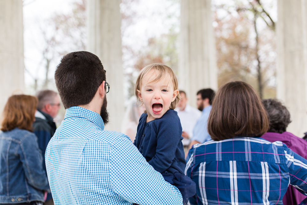 Little kid having fun during the wedding ceremony in Washington, DC